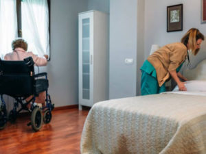 hospice aide helping patient
